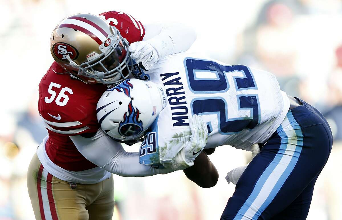 San Francisco 49ers outside linebacker Reuben Foster (56) tackles Tennessee Titans running back DeMarco Murray (29) during the first half of an NFL football game, Sunday, Dec. 17, 2017, in Santa Clara, Calif. (AP Photo/John Hefti)
