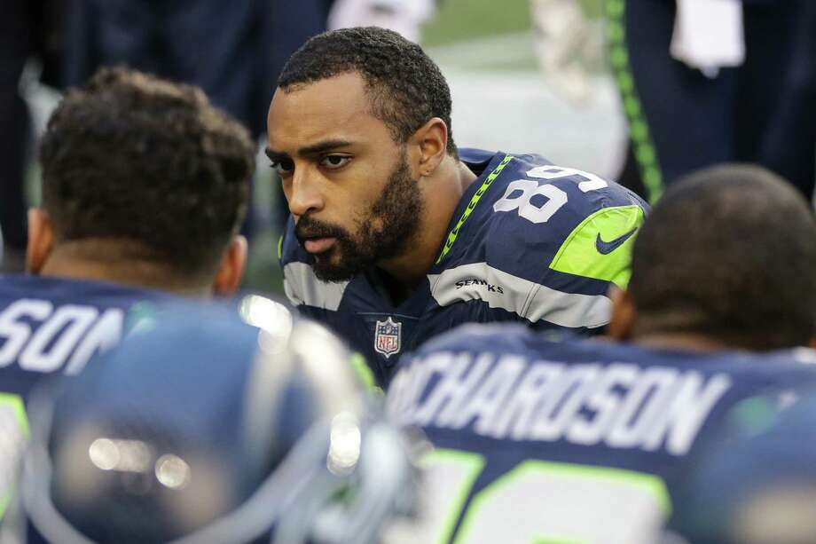 Seahawks wide receiver Doug Baldwin talks with quarterback Russell Wilson and wide receiver Paul Richardsond as their loss to the Rams becomes a reality during the second half of a football game at CenturyLink Field on Sunday, Dec. 17, 2017. Photo: GRANT HINDSLEY, SEATTLEPI.COM / SEATTLEPI.COM