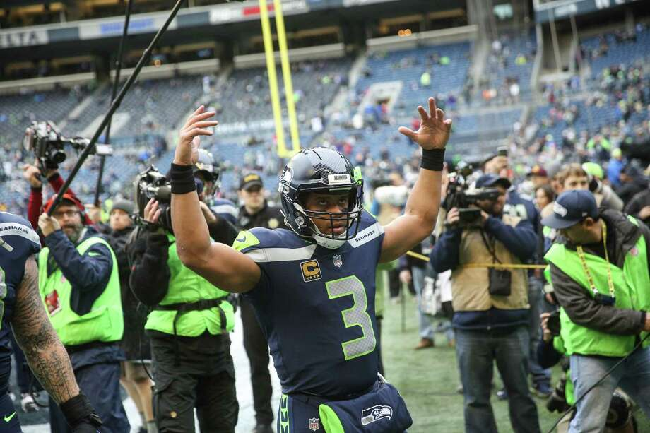 QUARTERBACKGrade: B+Russell Wilson threw for 3,983 yards and a league-best 34 touchdowns against 11 interceptions, averaging 7.2 yards per attempt with a 61.3 percent completion percentage. Wilson led the team in rushing with 586 yards and three of the team's four rushing touchdowns. Seattle got the best and worst of Wilson this season. The best is in numbers like his touchdown total and overall production numbers, a testament to his ability to carry the load offensively in a year when running the ball came without positive results. The worst came via sluggish first-half starts offensively, a unflattering characteristic that defined Seattle's season. Seattle was one of the worst first-half teams in the league offensively and Wilson's role in that is inarguable. (This breakdown from KJR's Curtis Crabtree is telling.) At the same time, Seattle was the highest-scoring second-half team in the league and Wilson's role in that is also inarguable. Wilson also led the league in fourth-quarter QB rating and passing touchdowns. Photo: GRANT HINDSLEY, SEATTLEPI.COM / SEATTLEPI.COM