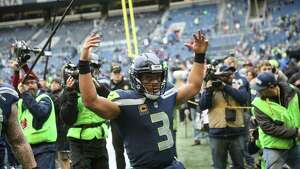 Seahawks quarterback Russell Wilson amps up the crowd as his teammates come out to warm up before playing the Los Angeles Rams at CenturyLink Field on Sunday, Dec. 17, 2017.