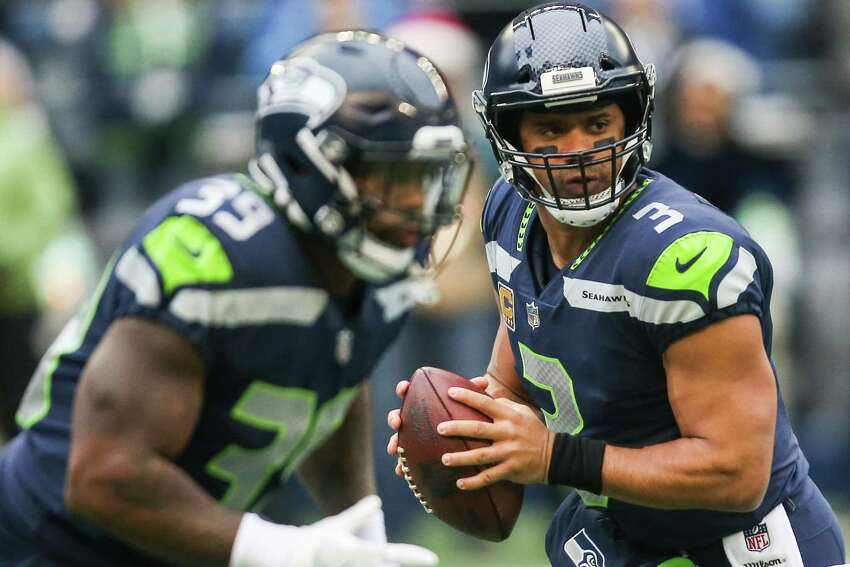 Seahawks quarterback Russell Wilson looks for an open man during the first half of a football game against the Los Angeles Rams at CenturyLink Field on Sunday, Dec. 17, 2017.
