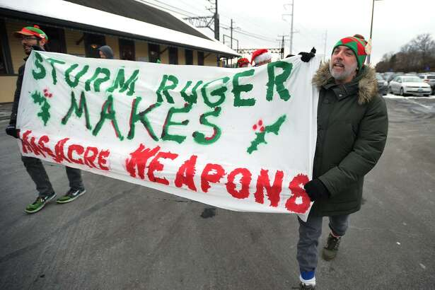 Jake Tolan, left, and Tim Murphy, march to gun maker Sturm Ruger's headquarters in Fairfield.