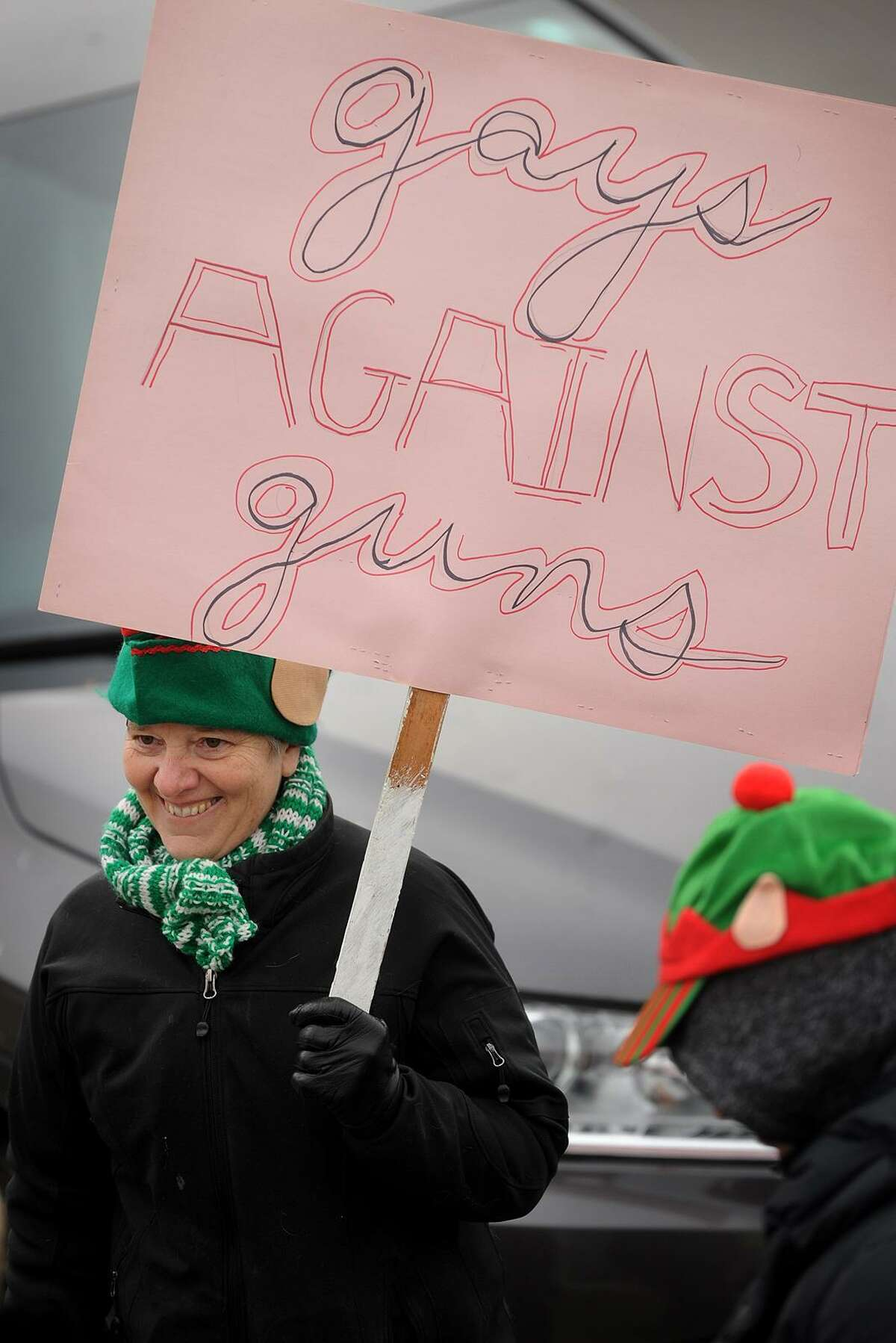 Christine Bisceglie, of Norwalk, marches with the New York-based group Gays Against Guns from the Fairfield Train Station to gun maker Sturm Ruger's headquarters in Fairfield on Sunday. Sturm Ruger manufactures the AR-556 assault rifle.