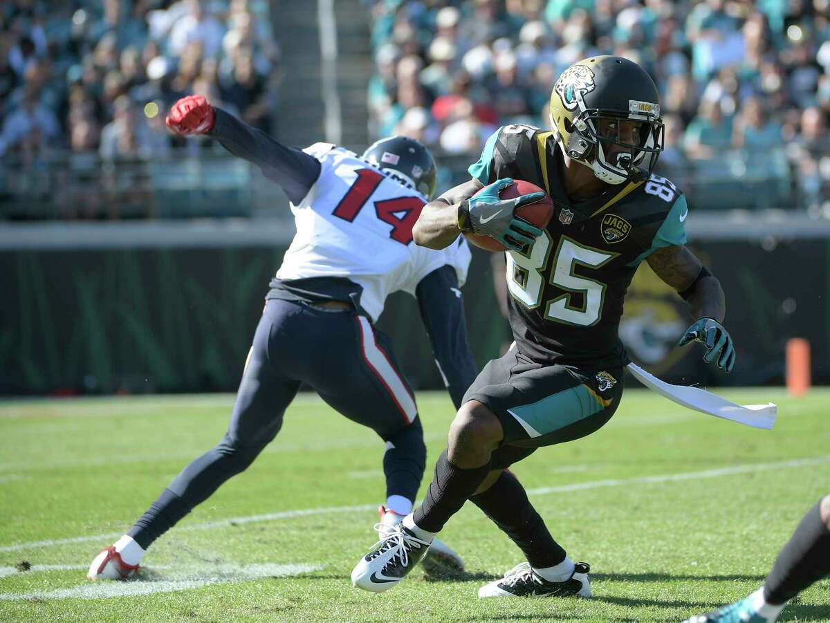 Jacksonville Jaguars' Jaydon Mickens (85) runs past Houston Texans' Chris Thompson (14) on a punt return during the first half of an NFL football game, Sunday, Dec. 17, 2017, in Jacksonville, Fla. (AP Photo/Phelan M. Ebenhack)