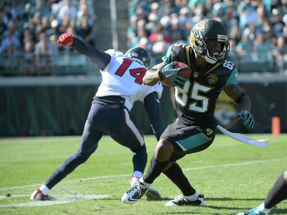 Jacksonville Jaguars' Jaydon Mickens (85) runs past Houston Texans' Chris Thompson (14) on a punt return during the first half of an NFL football game, Sunday, Dec. 17, 2017, in Jacksonville, Fla. (AP Photo/Phelan M. Ebenhack) Photo: Phelan M. Ebenhack, Associated Press / FR121174 AP