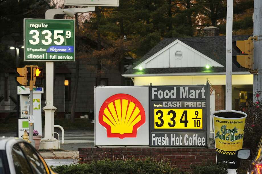 This file photo shows two gas stations listing per-gallon prices within one cent of each other on Hope Street in Stamford. Photo: Hearst Connecticut Media File Photo / Stamford Advocate