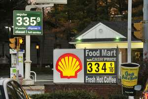 This file photo shows two gas stations listing per-gallon prices within one cent of each other on Hope Street in Stamford.