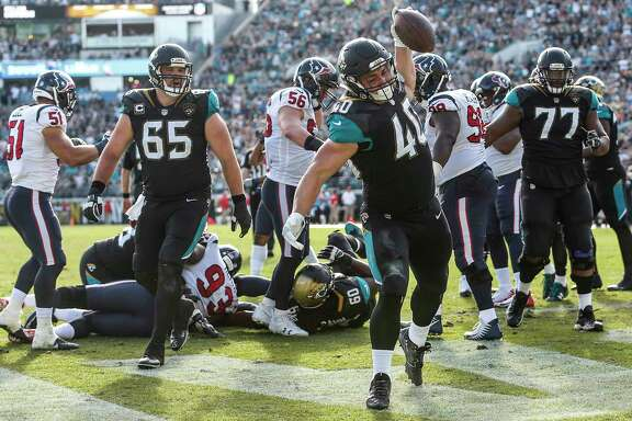 Jaguars fullback Tommy Bohanon (40) spikes the football after scoring on a 1-yard run during the third quarter against the Texans. Bohanon carried twice for 2 yards, but his touchdown answered the Texans' only score, a third-quarter TD pass to DeAndre Hopkins.