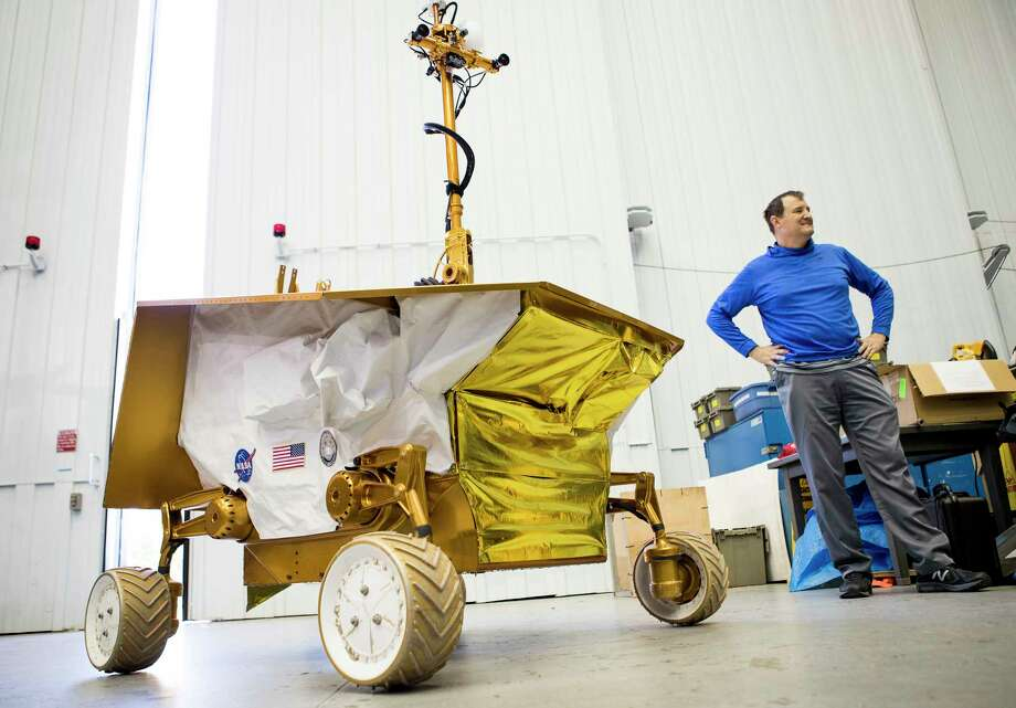 Bill Bluethmann, a NASA robotics engineer at Johnson Space Center, talks about the Resource Prospector rover, designed to drill into the moon's crust in search of water. Photo: Brett Coomer, Staff / © 2017 Houston Chronicle