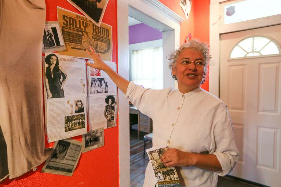 Graciela Sanchez, Director of Esperanza Peace & Justice Center, talks about a tribute to Eva Garza, a Lanier High School alumna, acclaimed singer and actress who grew up in the Alazan-Apace Courts, in the Casa De Cuentos (house of stories) building at MujerArtes Studio, 816 S. Colorao St., on Friday, Dec. 1, 2017.  Garza and several other women from the neighborhood are featured in the hallway of the building.  MARVIN PFEIFFER/mpfeiffer@express-news.net Photo: Marvin Pfeiffer, Staff / San Antonio Express-News / Express-News 2017