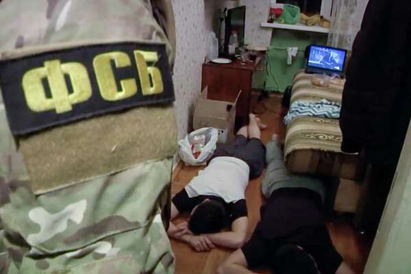 In this undated video grab provided by the RU-RTR Russian television via APTN in Moscow, Russia, Friday, Dec. 15, 2017,  Russian Federal Security Service (FSB) operatives detain a suspected member of the Islamic State group's cell in St. Petersburg, Russia.  The FSB said Friday the suspects were plotting a suicide bombing and a series of other explosions in the city's busiest areas this coming weekend. (Russian Federal Security ServiceAP video via AP) ORG XMIT: XAZ101