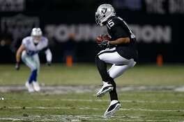 OAKLAND, CA - DECEMBER 17:  Michael Crabtree #15 of the Oakland Raiders makes a catch against the Dallas Cowboys during their NFL game at Oakland-Alameda County Coliseum on December 17, 2017 in Oakland, California.  (Photo by Lachlan Cunningham/Getty Images)
