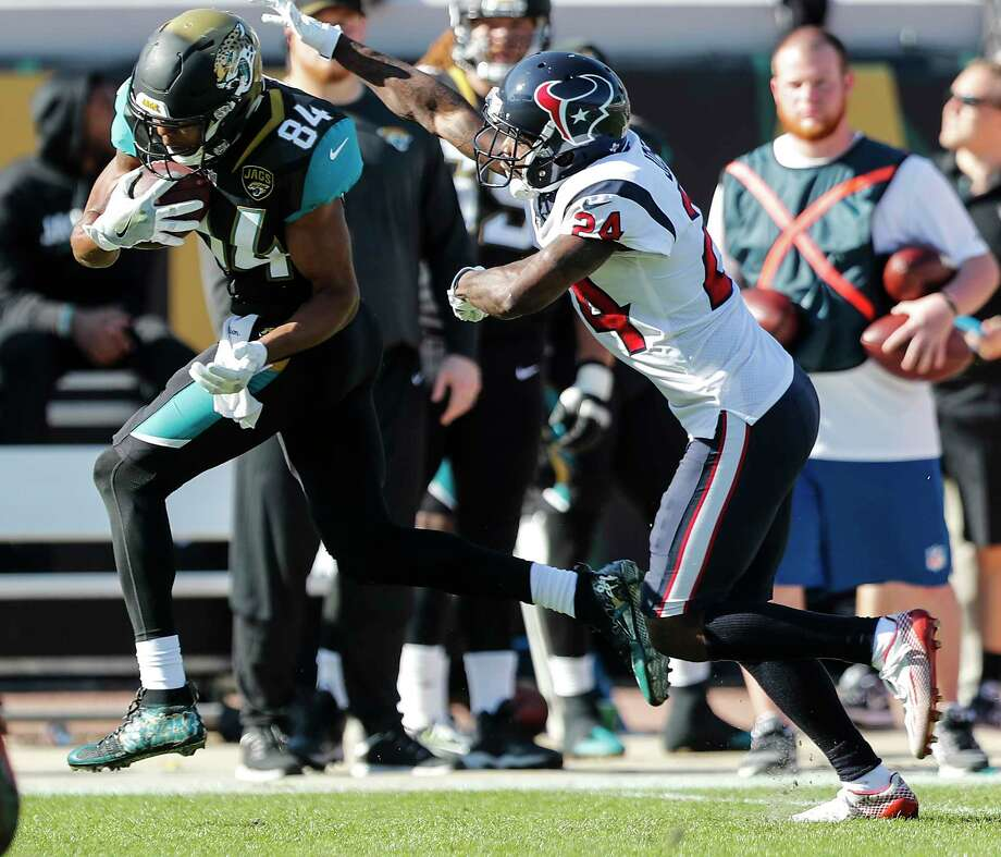 Jaguars backup wide receiver Keelan Cole, left, had seven receptions for 186 yards and a touchdown against the Texans, including a game-long 73-yarder. Photo: Brett Coomer, Staff / © 2017 Houston Chronicle