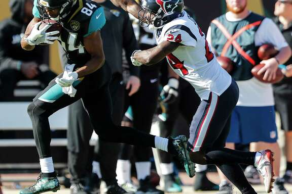 Jaguars backup wide receiver Keelan Cole, left, had seven receptions for 186 yards and a touchdown against the Texans, including a game-long 73-yarder.