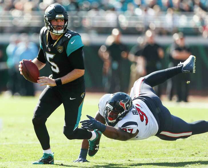 Jacksonville quarterback Blake Bortles, left, has shown marked improvement this season, passing for 3,147 yards, 19 touchdowns and eight interceptions.