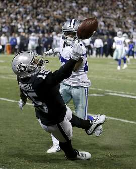Oakland Raiders wide receiver Michael Crabtree (15) cannot catch a pass in front of Dallas Cowboys cornerback Jourdan Lewis during the second half of an NFL football game in Oakland, Calif., Sunday, Dec. 17, 2017. (AP Photo/Ben Margot)