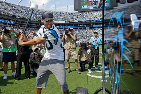 """Golden State Warriors and NBA MVP Stephen Curry prepares to """"Pound the Drum"""" before an NFL football game between the Carolina Panthers and the Houston Texans in Charlotte, N.C., Sunday, Sept. 20, 2015. (AP Photo/Bob Leverone)"""