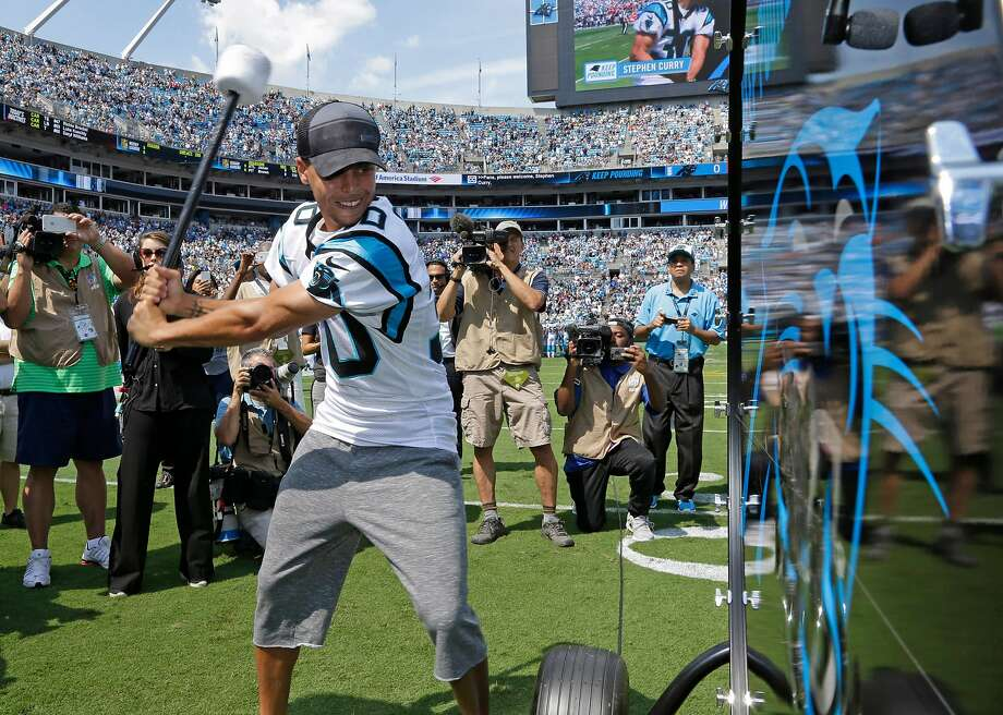 """Golden State Warriors and NBA MVP Stephen Curry prepares to """"Pound the Drum"""" before an NFL football game between the Carolina Panthers and the Houston Texans in Charlotte, N.C., Sunday, Sept. 20, 2015. (AP Photo/Bob Leverone) Photo: Bob Leverone, Associated Press"""