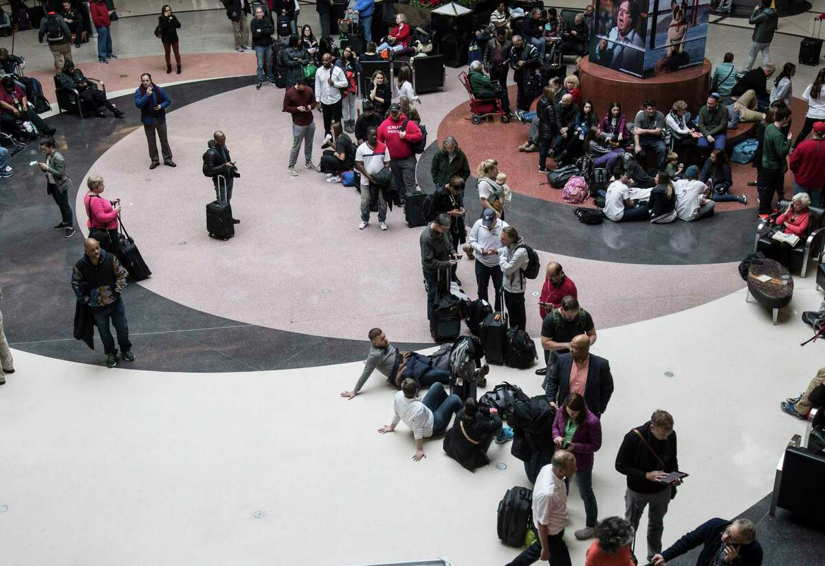 Long lines form at Hartsfield-Jackson International Airport after a power outage, Sunday, Dec. 17, 2017, in Atlanta. A sudden power outage at the Hartsfield-Jackson Atlanta International Airport on Sunday grounded scores of flights and passengers during one of the busiest travel times of the year. (Steve Schaefer/Atlanta Journal-Constitution via AP) ORG XMIT: GAATJ302