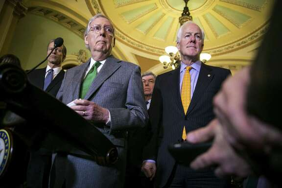 Senate Majority Leader Mitch McConnell, R-Ky., and Sen. John Cornyn, R-Texas, speak to reporters about the Alabama Senate race during a news conference on Capitol Hill. (Photo by Al Drago/Getty Images)