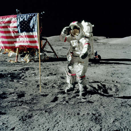 "Gene Cernan salutes the Stars & Stripes on the moon. (From the film ""The Last Man on the Moon."")   Photo: Jack Schmitt, NASA, Gravitas Ventures Photo: Jack Schmit / Jack Schmitt, NASA"