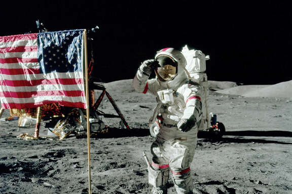 "Gene Cernan salutes the Stars & Stripes on the moon. (From the film ""The Last Man on the Moon."")   Photo: Jack Schmitt, NASA, Gravitas Ventures"