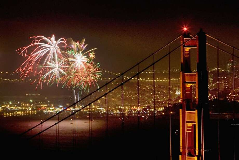 SAN FRANCISCO -  JULY 4:  Fireworks light up the Golden Gate Bridge and San Francisco Bay as Americans celebrate Independence Day on July 4, 2006 in San Francisco, California. (Photo by David Paul Morris/Getty Images) Photo: David Paul Morris, Getty Images / 2006 Getty Images