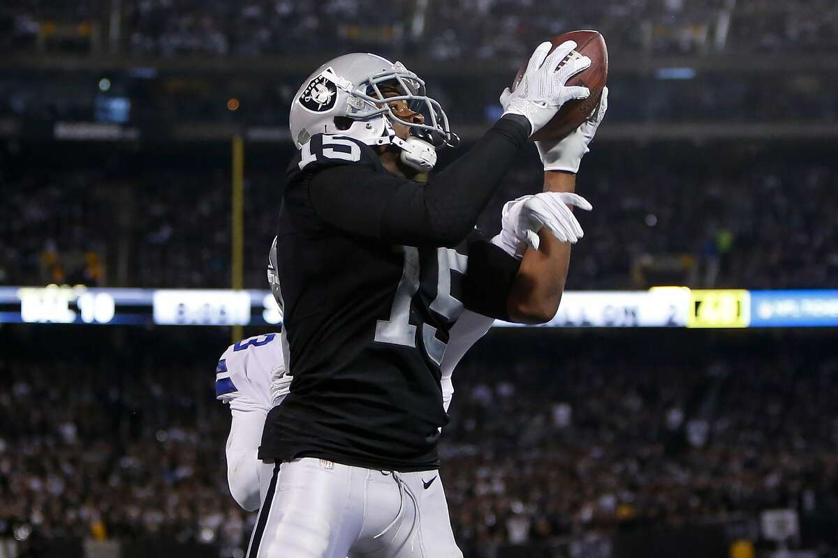 OAKLAND, CA - DECEMBER 17: Michael Crabtree #15 of the Oakland Raiders makes a catch for a two-yard touchdown against the Dallas Cowboys during their NFL game at Oakland-Alameda County Coliseum on December 17, 2017 in Oakland, California. (Photo by Lachlan Cunningham/Getty Images)