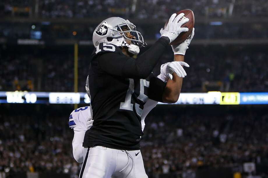 OAKLAND, CA - DECEMBER 17:  Michael Crabtree #15 of the Oakland Raiders makes a catch for a two-yard touchdown against the Dallas Cowboys during their NFL game at Oakland-Alameda County Coliseum on December 17, 2017 in Oakland, California.  (Photo by Lachlan Cunningham/Getty Images) Photo: Lachlan Cunningham, Getty Images