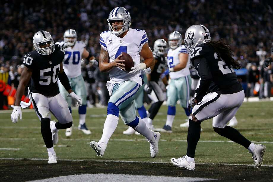Dak Prescott #4 of the Dallas Cowboys scores on a five-yard run against the Oakland Raiders during their NFL game at Oakland-Alameda County Coliseum on December 17, 2017 in Oakland, California.  (Photo by Lachlan Cunningham/Getty Images) Photo: Lachlan Cunningham, Getty Images