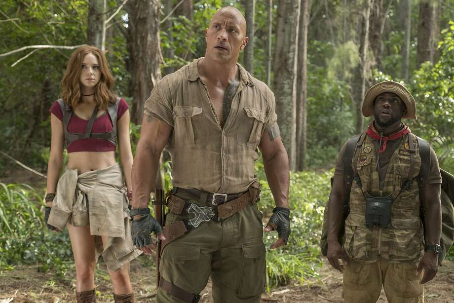 "This image released by Sony Pictures shows Karen Gillan, from left, Dwayne Johnson and Kevin Hart in ""Jumanji: Welcome to the Jungle."" (Frank Masi/Sony Pictures via AP) Photo: Frank Masi, Associated Press"