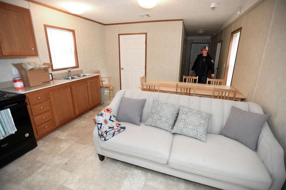 Aaron Long walks through his FEMA trailer after being handed the keys on Thursday. Long an Orange firefighter said the trailer sat empty on his lot for several weeks while waiting on a sprinkler system to be installed. Photo taken Thursday, December14, 2017 Guiseppe Barranco/The Enterprise Photo: Guiseppe Barranco, Photo Editor / Guiseppe Barranco ©