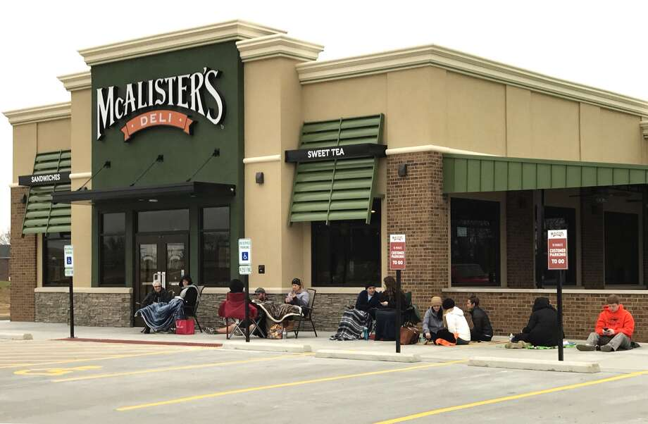 Locals are currently gathered at the new Edwardsville McAlister's Deli in hopes to receive free tea for a year. The first 100 people to enter the restaurant at 10:30 a.m. Monday morning will receive a free tea punch card that will allow patrons to get free tea for a year, dine-in only. Photo: Cody King • Cking@edwpub.net
