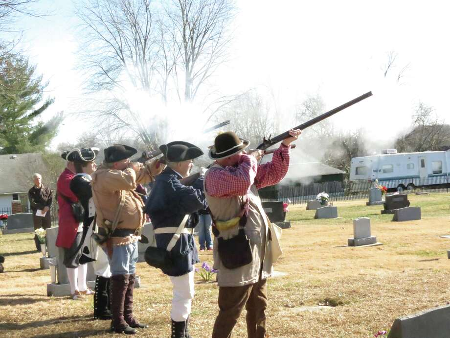 Members of the GGRC Chapter color guard fire their weapons in a salute to the fallen. Photo: For The Intelligencer