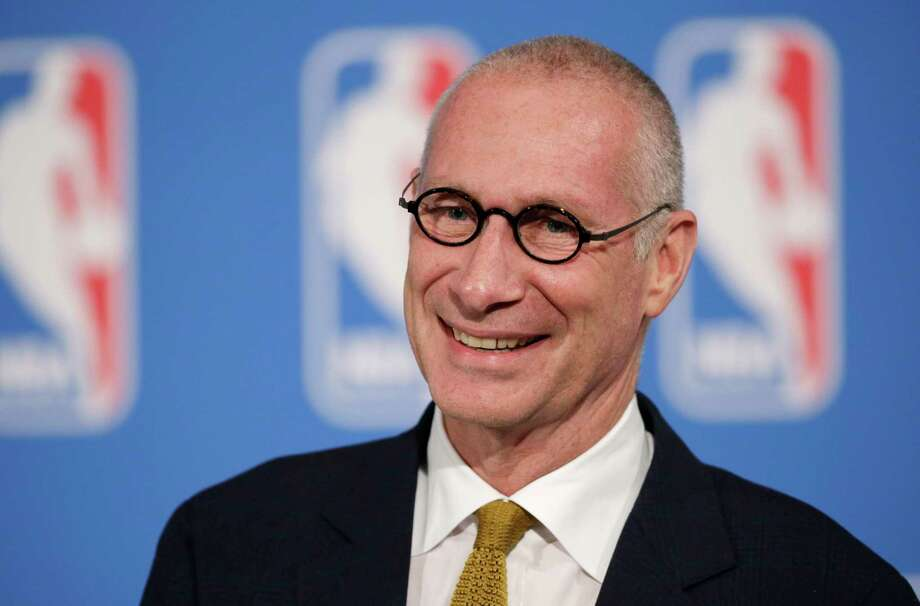 "FILE - In this Oct. 6, 2014, file photo, ESPN President John Skipper smiles during a news conference in New York. Disney's ESPN on Wednesday, Oct. 21, 2015 confirmed it is cutting about 300 jobs, or 4 percent of its staff, amid signs that the traditional cable bundle is less far-reaching than it once was. Skipper says, in a memo to employees that was posted online, these cuts are part of changes being made to keep ESPN as the ""premier sports destination on any platform."" (AP Photo/Mark Lennihan, File) Photo: Mark Lennihan, Associated Press / AP"