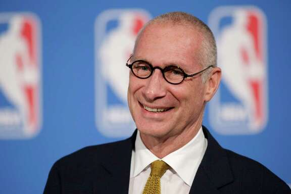 """FILE - In this Oct. 6, 2014, file photo, ESPN President John Skipper smiles during a news conference in New York. Disney's ESPN on Wednesday, Oct. 21, 2015 confirmed it is cutting about 300 jobs, or 4 percent of its staff, amid signs that the traditional cable bundle is less far-reaching than it once was. Skipper says, in a memo to employees that was posted online, these cuts are part of changes being made to keep ESPN as the """"premier sports destination on any platform."""" (AP Photo/Mark Lennihan, File)"""