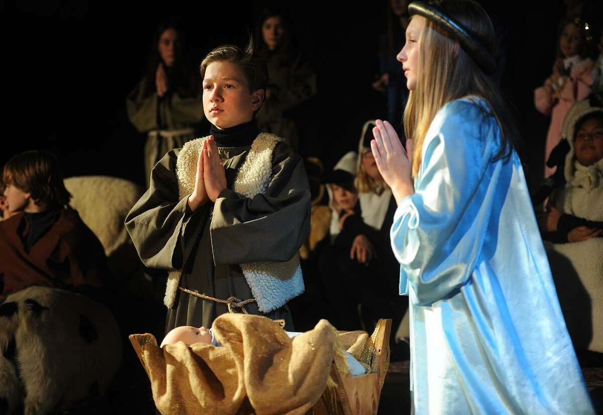 James Auszura performs as Joseph and Ceci Andersen as Mary in the 93rd Annual Christmas Pageant at Trinity Episcopal Church in the Southport section of Fairfield, Conn. on Sunday, December 17, 2017.