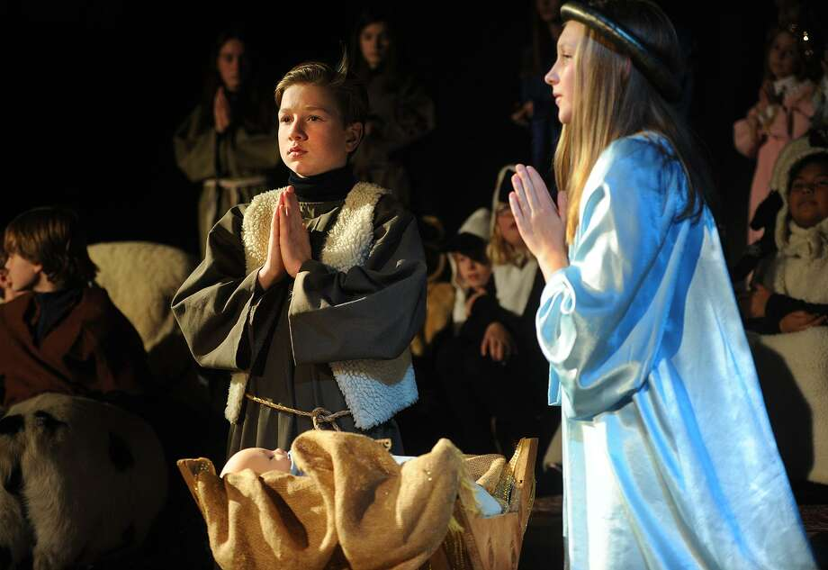 James Auszura performs as Joseph and Ceci Andersen as Mary in the 93rd Annual Christmas Pageant at Trinity Episcopal Church in the Southport section of Fairfield, Conn. on Sunday, December 17, 2017. Photo: Brian A. Pounds / Hearst Connecticut Media / Connecticut Post
