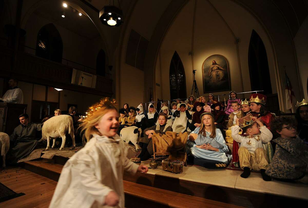 Campbell Dobson, 4, of Easton, runs to her family following her participation in the 93rd Annual Christmas Pageant at Trinity Episcopal Church in the Southport section of Fairfield, Conn. on Sunday, December 17, 2017.