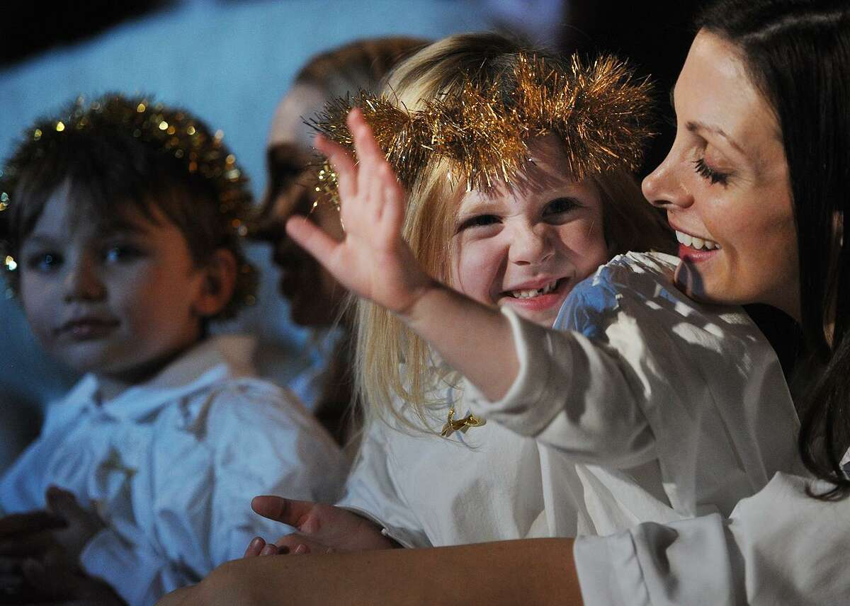 Campbell Dobson, 4, of Easton, waves to family as she participates with mom Mary in the 93rd Annual Christmas Pageant at Trinity Episcopal Church in the Southport section of Fairfield, Conn. on Sunday, December 17, 2017.