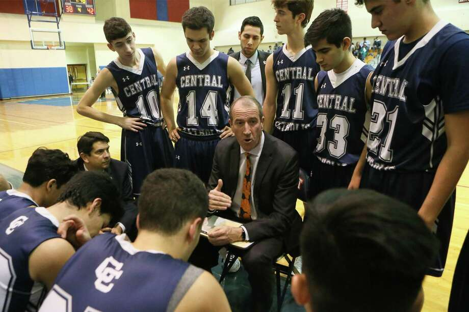 Central Catholic head basketball coach Bruce McConaghy talks to the Buttons during a timeout in a nondistrict game with Roosevelt in December 2017. Photo: Marvin Pfeiffer / San Antonio Express-News / Express-News 2017