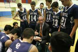 Central Catholic head basketball coach Bruce McConaghy talks to the Buttons during a timeout in a nondistrict game with Roosevelt in December 2017.