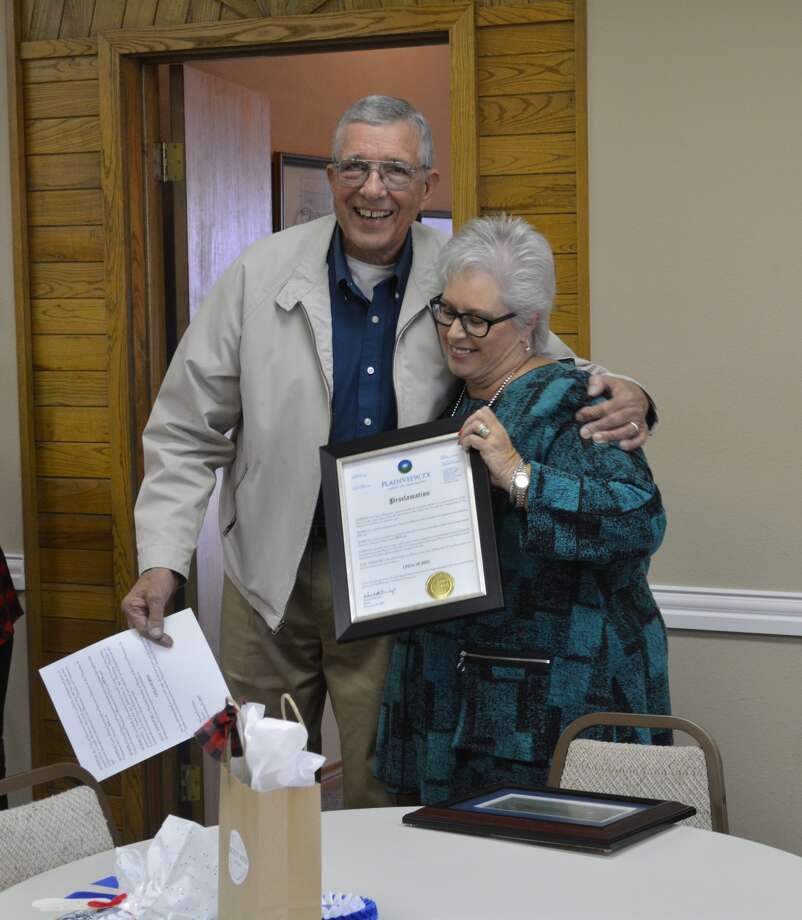 Plainview Mayor Wendell Dunlap presents Plainview Chamber Director Linda Morris with a proclamation honoring her for her years of service to the chamber during an open house event Friday. Morris is retiring as chamber director after nearly seven years at the helm of the organization. Photo: William Carroll, Plainview Herald