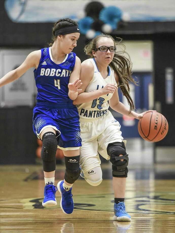 South San's Rhiannon Gamez (left), a senior guard, bumps United South's Stef Galindo as Galindo tries to move the ball down the court Tuesday, Dec. 12. Bobcats lost the hard-fought game, 69-65. Photo: Danny Zaragoza /Laredo Morning Times