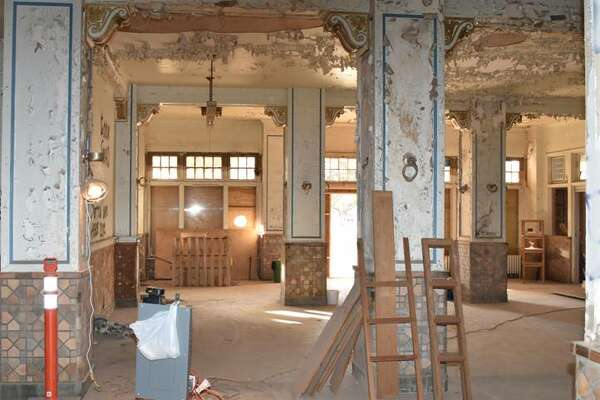 View looking from registration desk to the original entrance of the Hilton.  All original moulding and décor is to be preserved, and all the windows with transoms above will be replaced with custom made metal windows with the same dimensions.