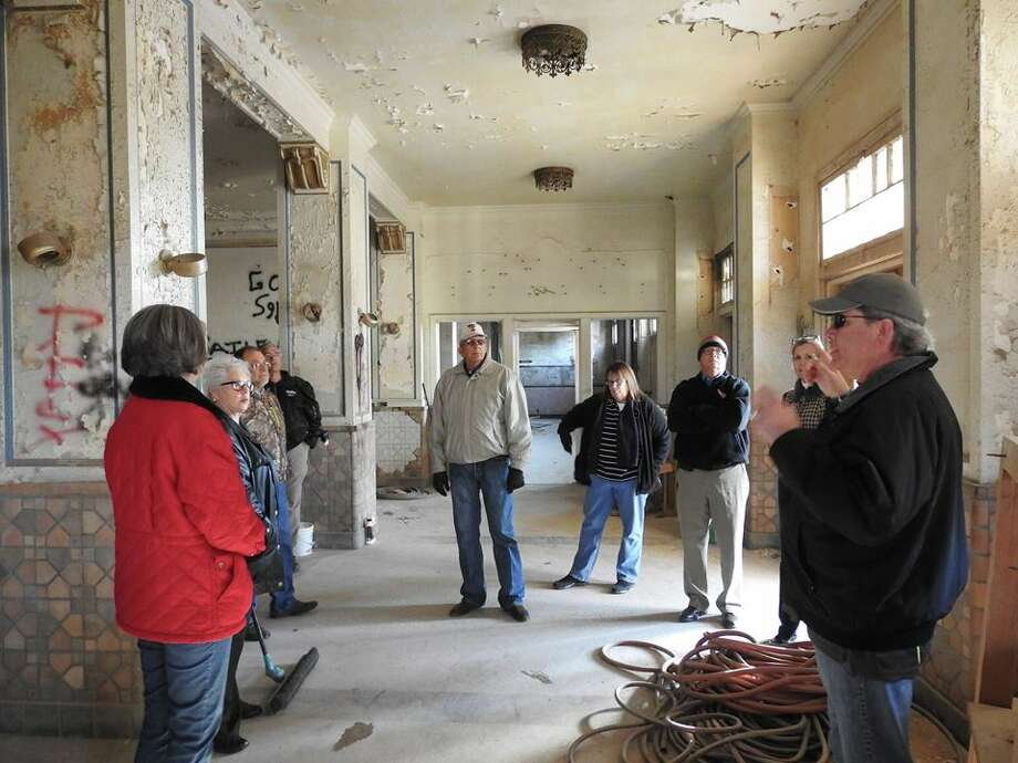 Jack, Linda Morris, Blaine Smith, Gordon Zeigler, Mayor Wendell Dunlap, Susan Blackerby, Mike Fox and Tonya Keesee listen to Damon Admire, construction contractor on the project to renovate the old Hilton Hotel in downtown Plainview, discuss the developments being made on the project. Photo: Gordon Ziegler