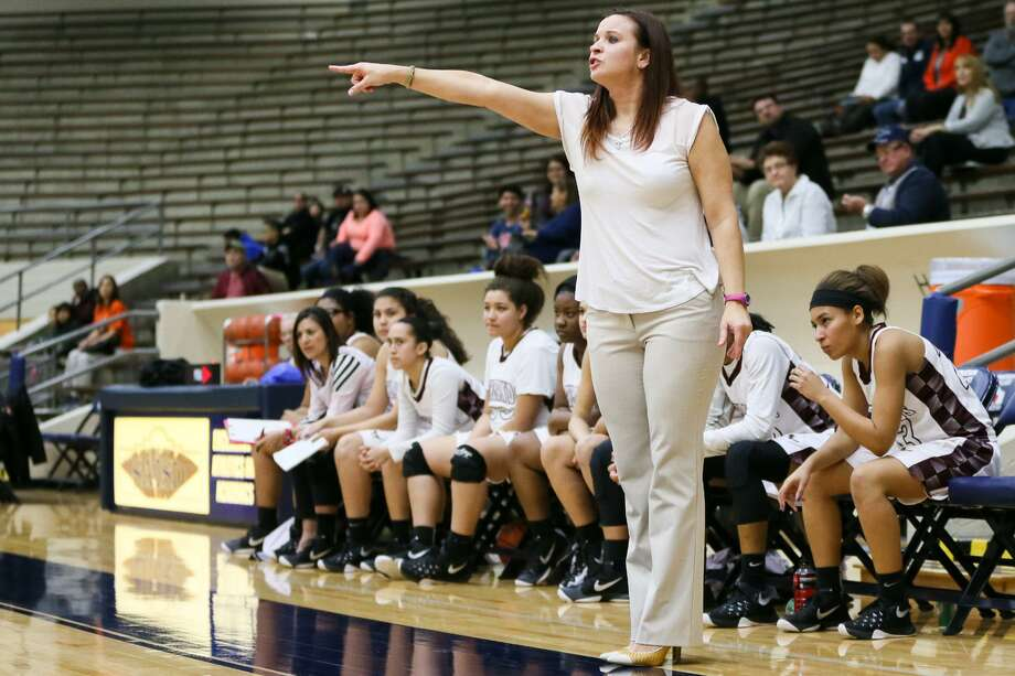 """Highlands' coach Adrianna Wiatrek gives instructions from the sideline during a game last year with Burbank at the Alamo Convocation Center. Highlands won that game, but lost decisively to Burbank last week 63-39. Wiatrek said her team does well in the first half, then the third quarter """"gets us."""" Meanwhile, Burbank has been steadily improving. Photo: Marvin Pfeiffer /San Antonio Express-News / Express-News 2015"""