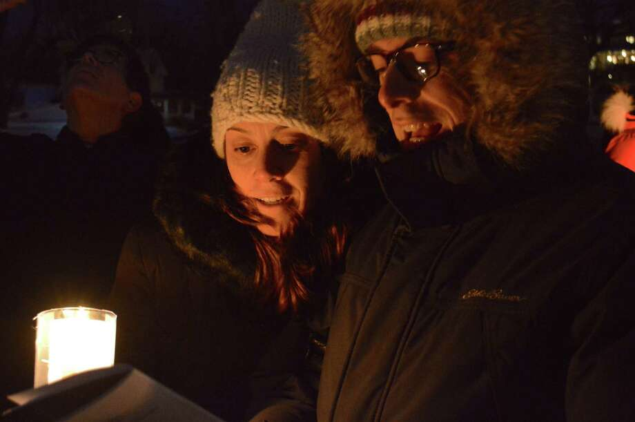 Nicole and Ben Hirschler of Darien taking part in the Christmas carol sing-along organized by the Friends of Gorham's Pond, on Rings End Bridge, Sunday, Dec. 17, 2017, in Darien, Conn. Photo: Jarret Liotta / For Hearst Connecticut Media / Darien News Freelance