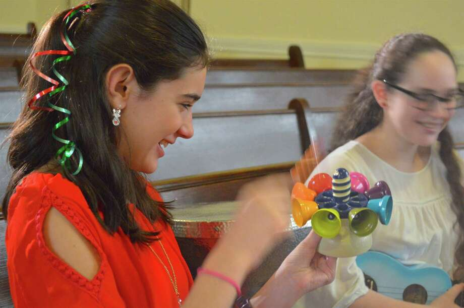 Allison Eidt, 12, of Wilton, tries out a unique kind of instrument at the Free Family Concert at the Seabury Center, sponsored by the Westport Historical Society and Mary Ann Hall's Music for Children and Beyond, Sunday, Dec. 17, 2017, in Westport, Conn. Photo: Jarret Liotta / For Hearst Connecticut Media / Westport News Freelance