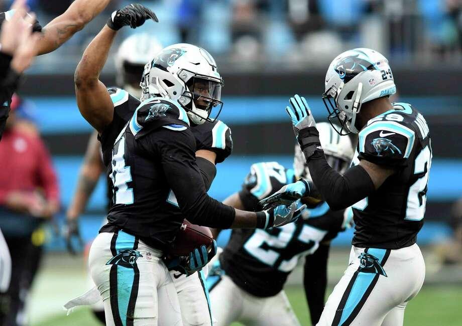 Carolina Panthers cornerback James Bradberry (24) celebrates his interception against the Green Bay Packers with strong safety Mike Adams (29) in the second half on Sunday, Dec. 17, 2017 at Bank of America Stadium in Charlotte, N.C. The Panthers won, 31-24. Photo: David T. Foster III, TNS / Charlotte Observer